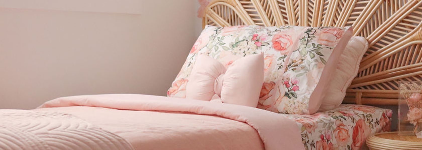Brianne Bedding and Pink Linen Duvet on a rattan single bed
